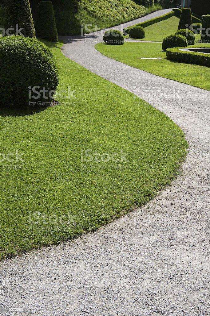 Sidewalk in a garden royalty-free stock photo