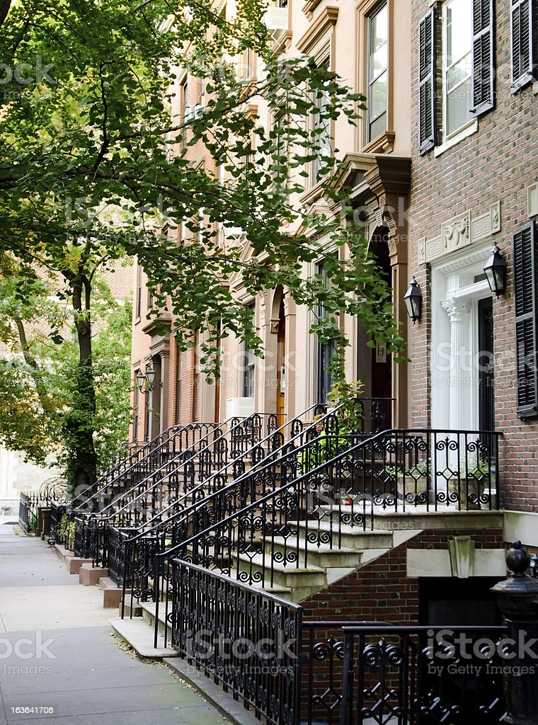 Sidewalk next to Brooklyn Heights homes in New York City royalty-free stock photo