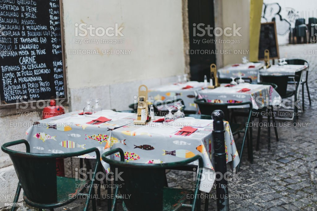 Sidewalk restaurant in Alfama district, Lisbon, Portugal stock photo