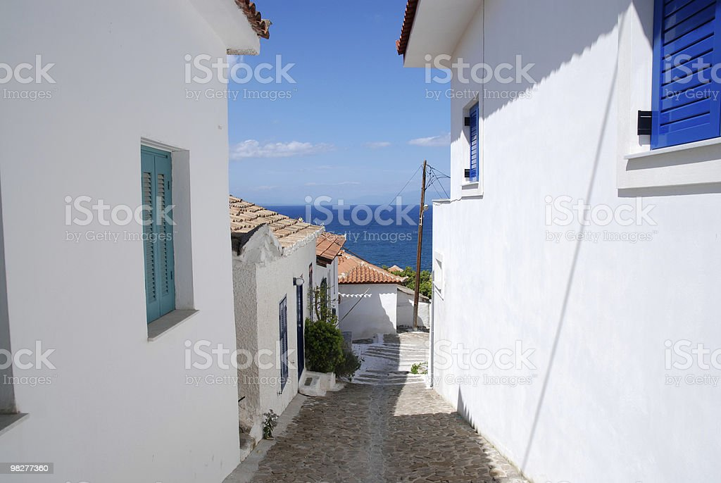 sidewalk to the beach in greek village royalty-free stock photo