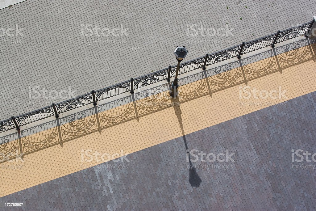 sidewalk top-view with street-lamp and nice shadows royalty-free stock photo
