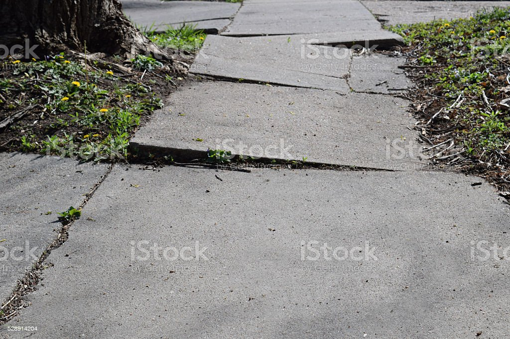 Sidewalk Trouble stock photo
