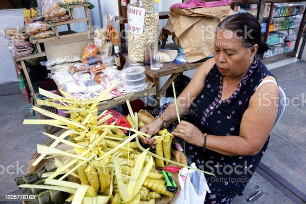 Sidewalk vendor sells suman or steamed glutenous rice in palm tree picture id1205776163?b=1&k=6&m=1205776163&s=612x612&h=egybcmc8ibl2xyegamm2yec7im6sevlkgpuxrq41cwy=