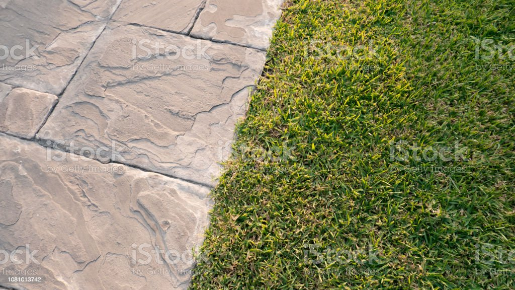 Sidewalk with grass on the side stock photo