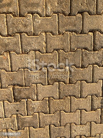 Concrete or cobble gray H Shaped pavement slabs or stones
