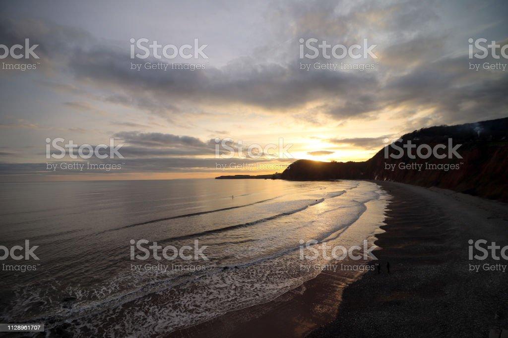 Sidmouth Beach Sun Set stock photo