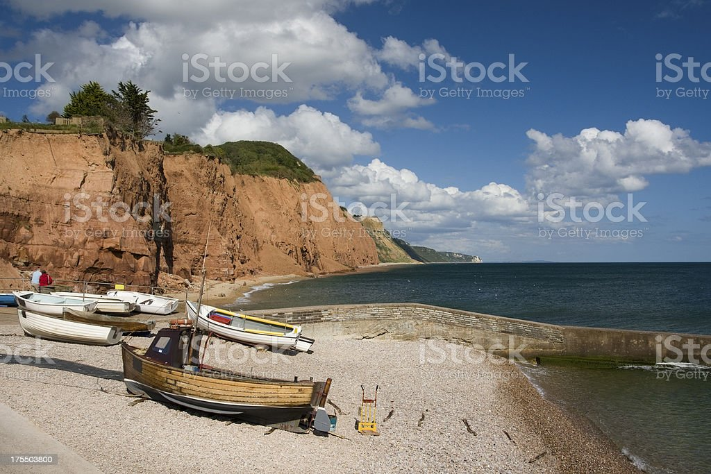 Sidmouth boats and cliffs on the south coast of Devon stock photo