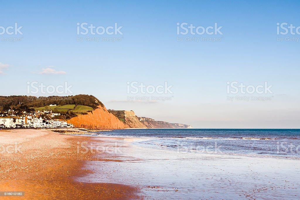 Sidmouth esplanade beach and sandstone cliffs in Devon, England stock photo