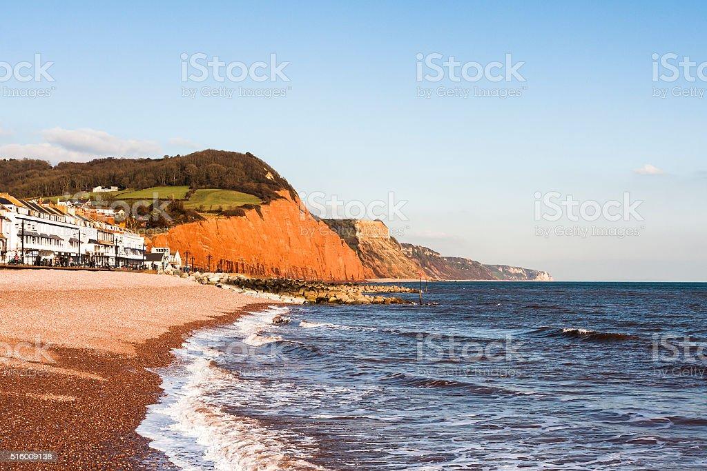Sidmouth esplanade pebble beach and sandstone cliffs in Devon, England stock photo