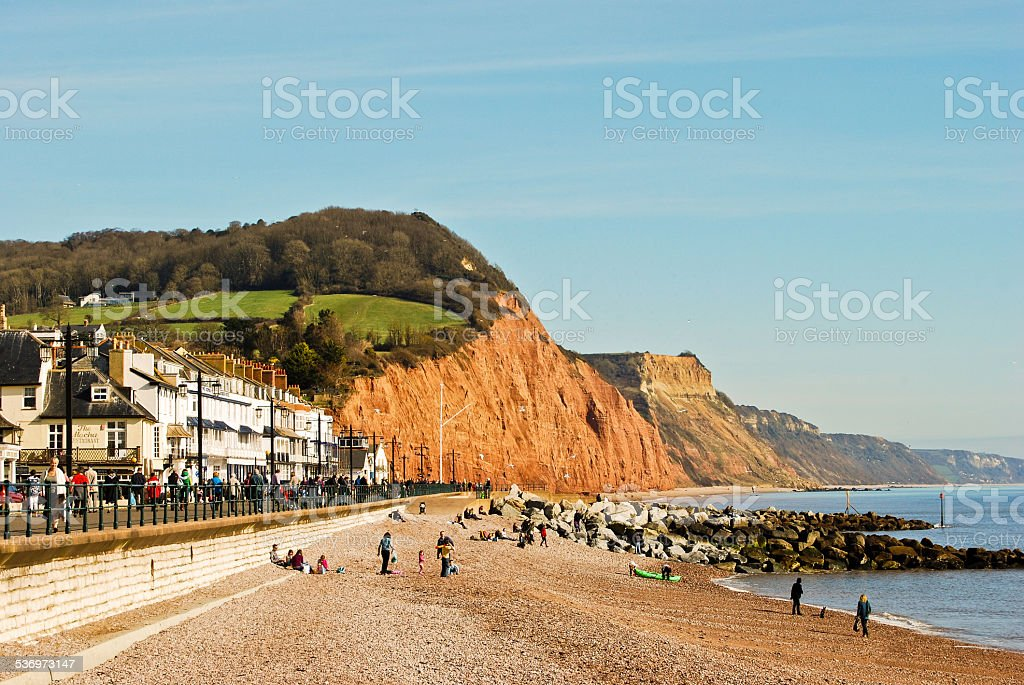 Sidmouth seafront with red cliffs of Jurassic Coast, Devon England stock photo