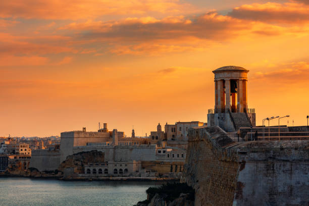 Siege Bell War Memorial and old fortress in Valletta, Malta. stock photo