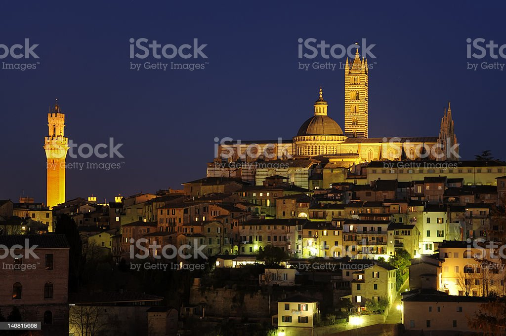 Siena Cathedral and cityscape after sunset, Tuscany italy stock photo