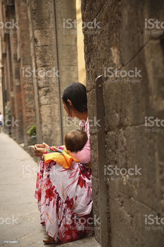 Siena: Gypsy and Child royalty-free stock photo