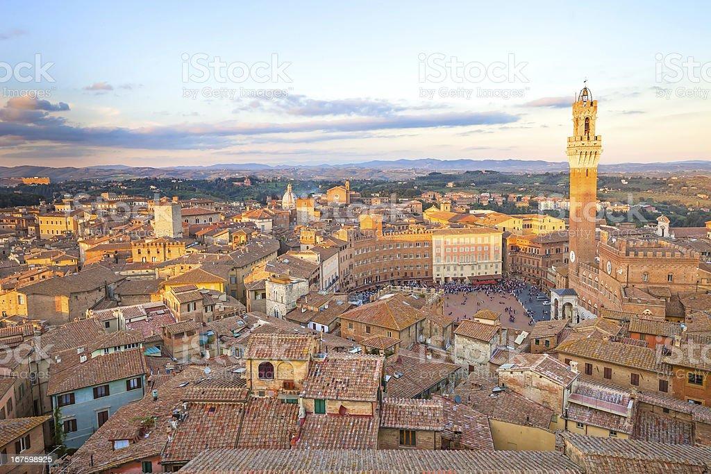 Siena sunset panoramic skyline. Mangia tower landmark. Tuscany, royalty-free stock photo