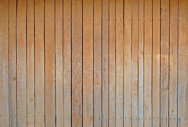 sienna brown old wooden fence. wood palisade background. planks texture - palisade boundary stock photos and pictures