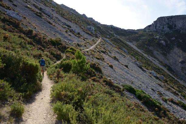 Sierra de Bernia Loop Track passing the Fort of Bernia, Costa Blanca, Spain stock photo