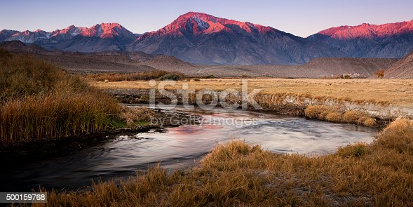 Alpenglow at dawn over California's Sierra Nevada mountains in the Owens River Valley.