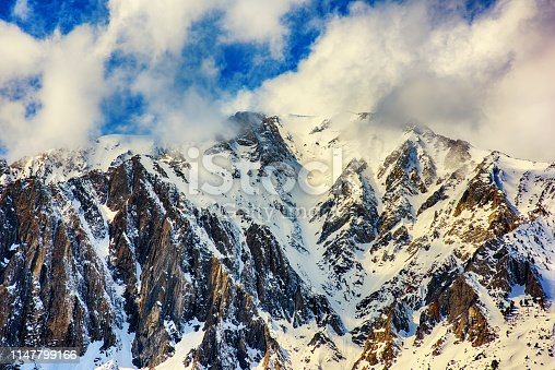 The peak of a snow capped mountain in the eastern Sierra Nevada mountain range near Mammoth Lakes, California.