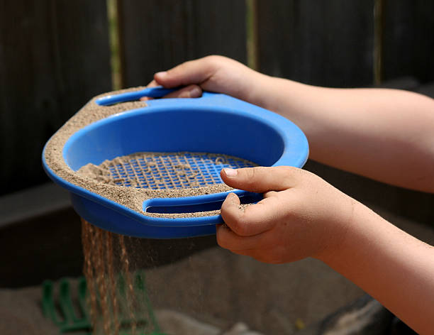 Sieving Sand stock photo