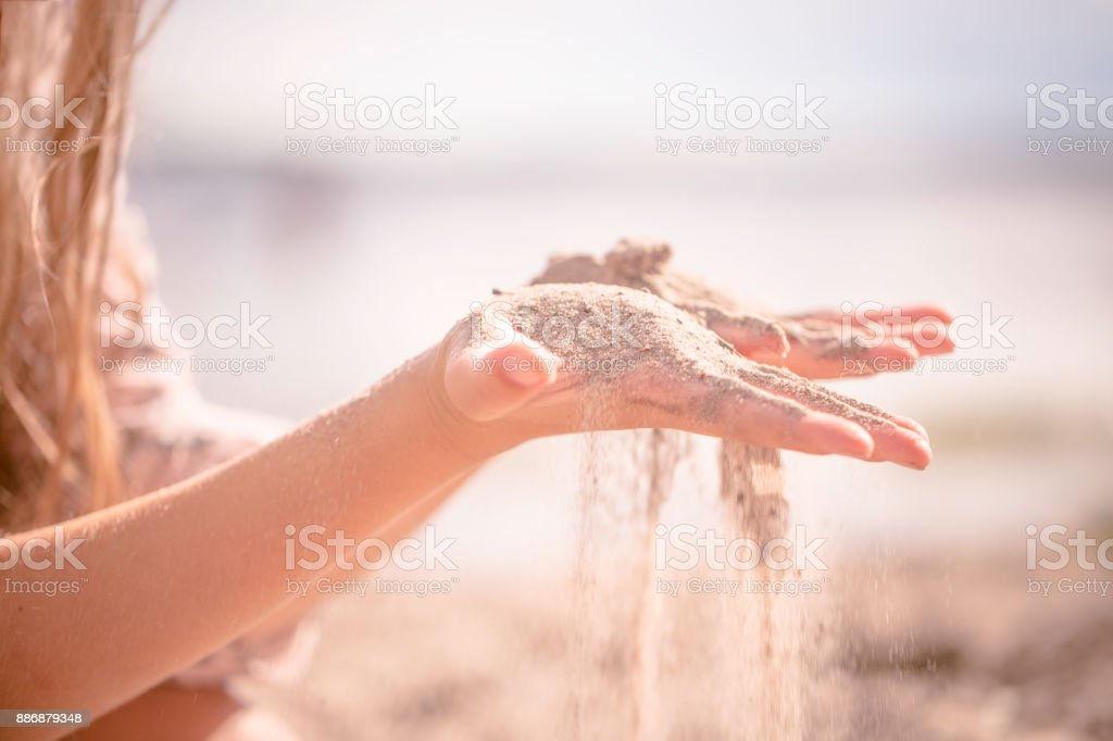Sifting sand in summer Sweden stock photo