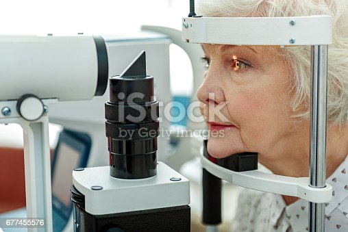 istock Sight of old woman verifying by apparatus 677455576