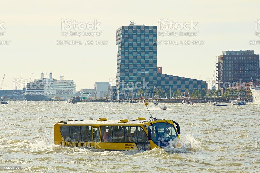 Sightseeing amphibian bus driving through Rotterdam harbor stock photo