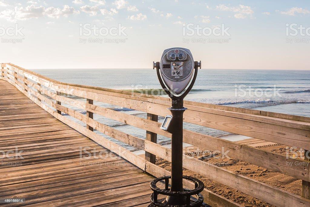 Sightseeing Binoculars On Pier And Beach Stock Image