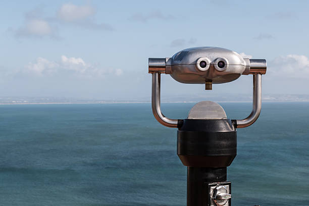 Sightseeing Binoculars Overlooking Ocean From Up High stock photo