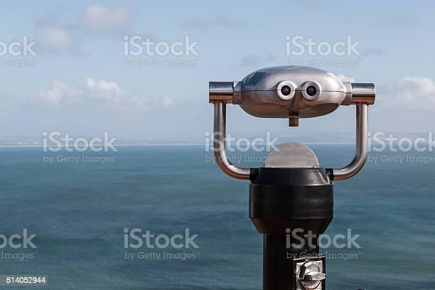 Sightseeing Binoculars Overlooking Ocean From Up High Stock Photo - Download Image Now