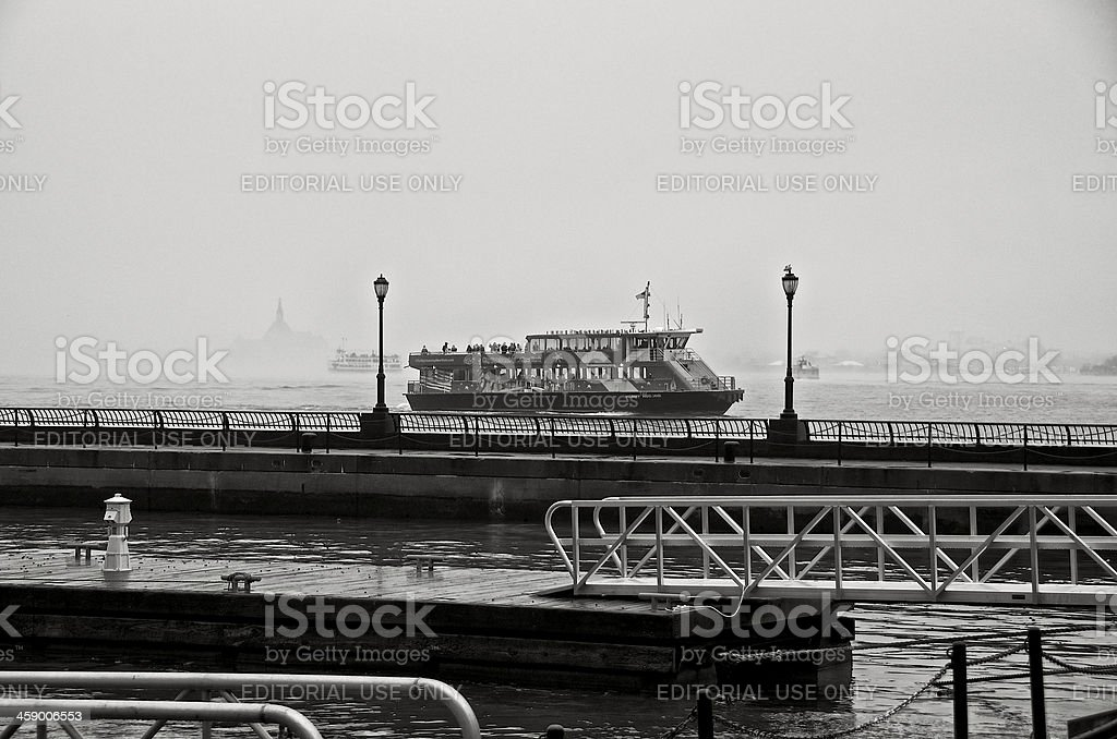 Sightseeing boat in fog, Hudson River from Lower Manhattan, NYC royalty-free stock photo