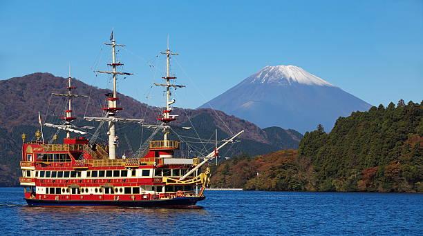 Sightseeing ship at lake Ashi and Mountain Fuji in background stock photo