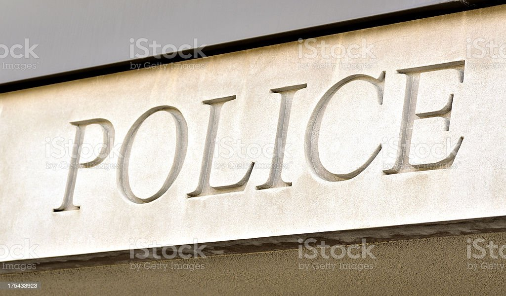 Sign above station door reading police royalty-free stock photo