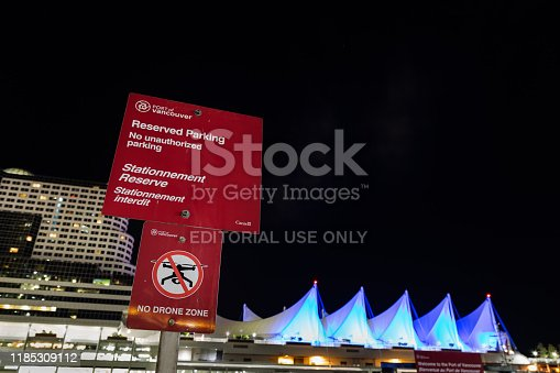 istock Sign advertising the restriction of drone flights in the area in front of the Five Sails Pan Pacific Hotel in Vancouver harbor. 1185309112