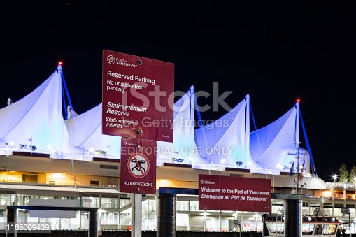 istock Sign advertising the restriction of drone flights in the area in front of the Five Sails Pan Pacific Hotel in Vancouver harbor. 1185309439