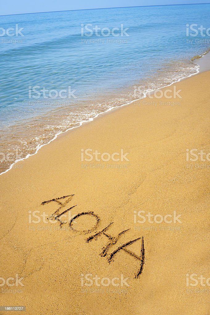 Sign aloha written in sand, on tropical beach stock photo