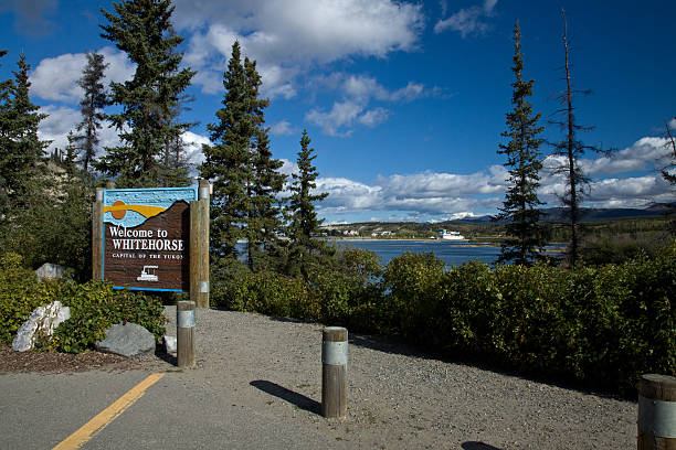 sign along the yukon river. whitehorse, yukon, canada - yt stock pictures, royalty-free photos & images