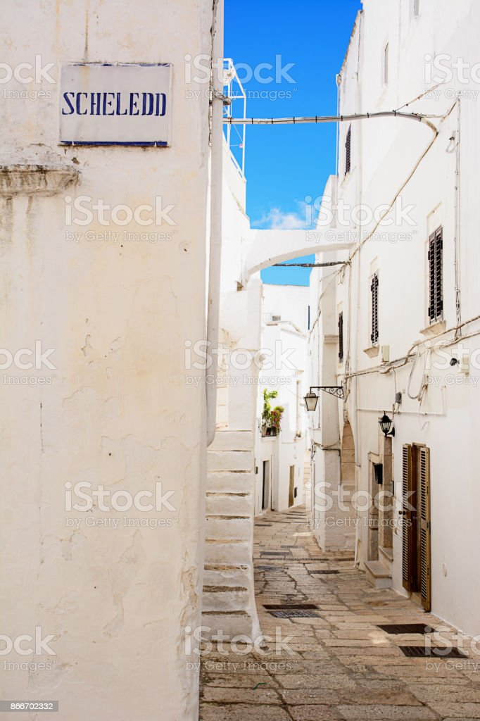 Sign and alley in Cisternino (Italy) stock photo