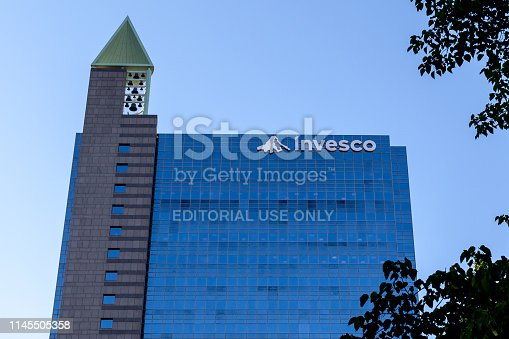 Toronto, Ontario, Canada - June 25, 2018: Sign and logo of Invesco on the Canadian head office building in Toronto. Invesco Ltd. is an American independent investment management company.
