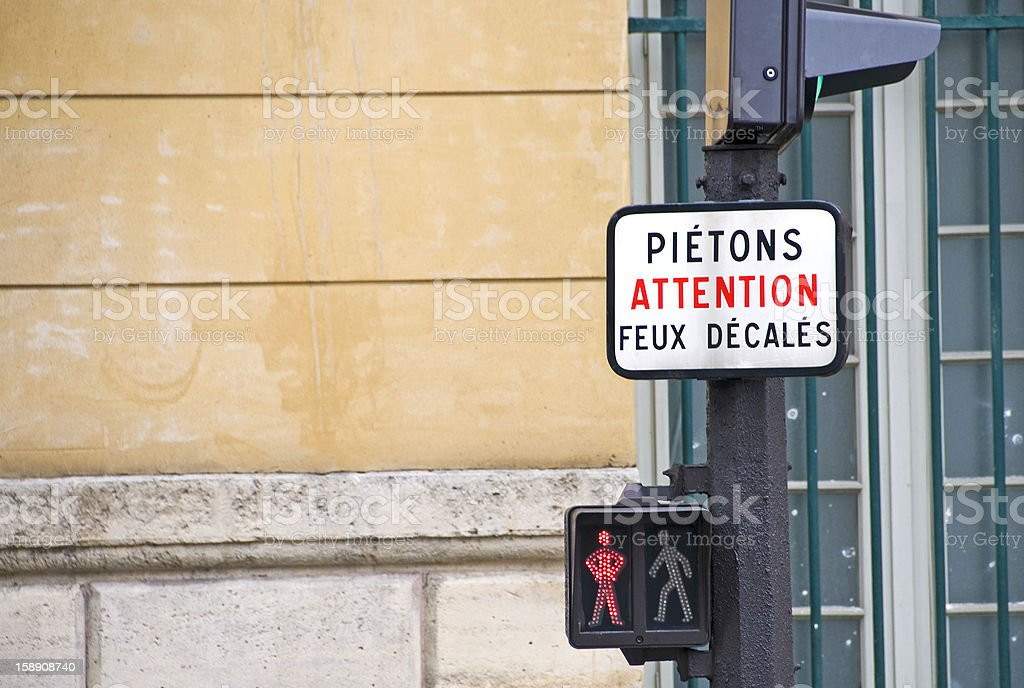 Sign and traffic light in Paris stock photo