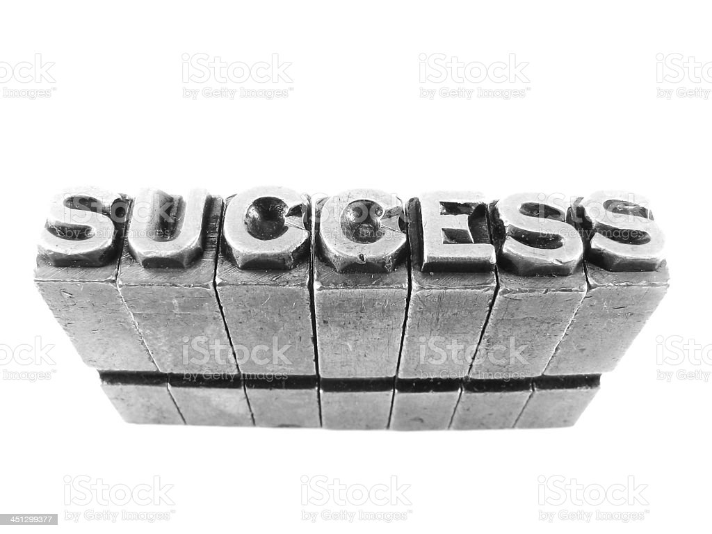 SUCCESS sign, antique metal letter type isolated royalty-free stock photo