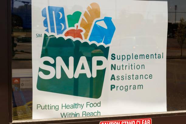 A Sign at a Retailer - We Accept SNAP IV stock photo
