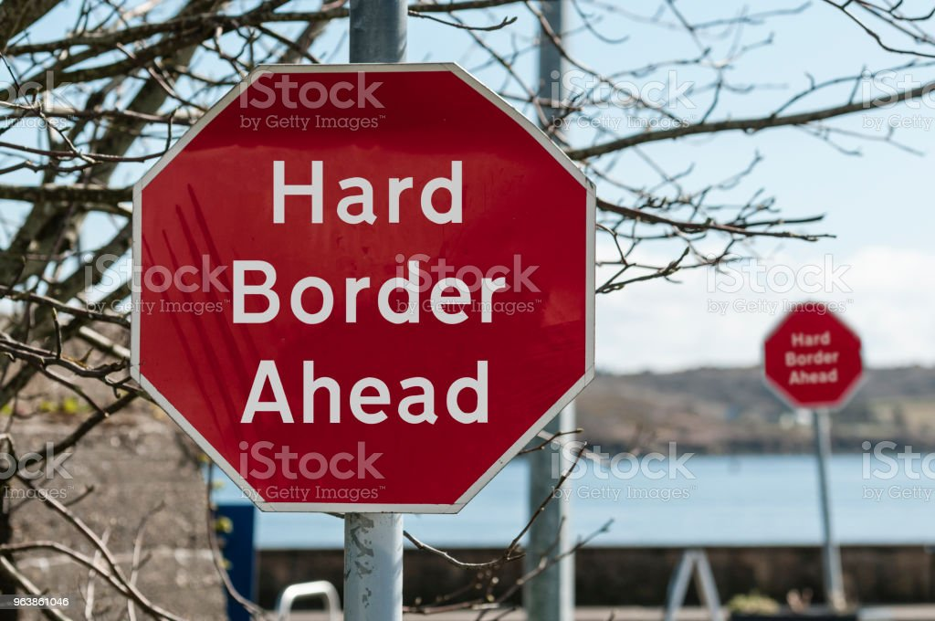 """Sign at a stop junction in Ireland saying """"Hard Border Ahead"""" - Royalty-free Article 50 of the Treaty on European Union Stock Photo"""