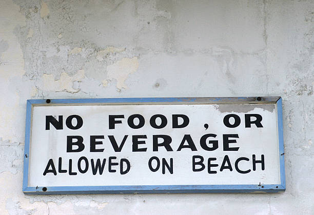 sign at beach stock photo