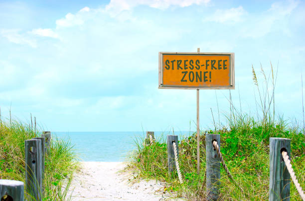 STRESS-FREE ZONE sign at beutiful beach path to ocean stock photo