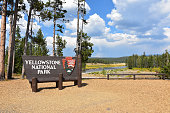 Yellowstone National Park, Wyoming, USA - September 6, 2018 Sign at the South Entrance - welcomes visitors to the park with the Snake River in the background