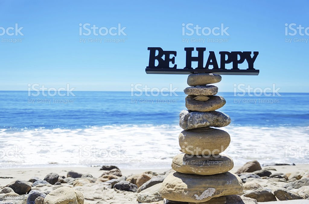 Sign 'Be Happy' on balanced rocks royalty-free stock photo