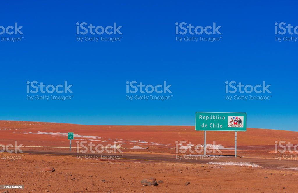 Sign by the border to Chile and Bolivia in the Andes stock photo