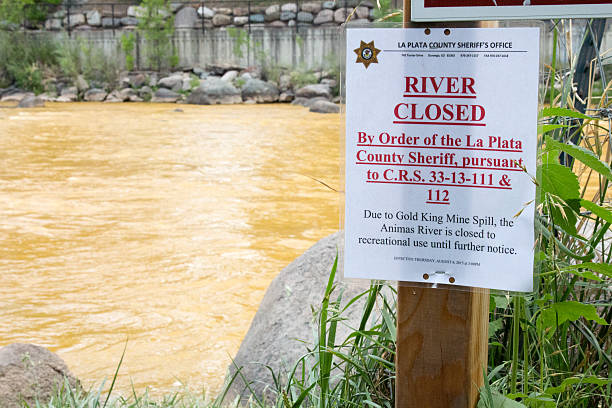 Sign closing the Animas River due to toxic waste Durango, CO, USA - August 7, 2015: Sign posted on the orange hued Animas River in Durango, Colorado that says the river is closed due to the Gold King Mine Spill that poured toxic waste into the river. animas river stock pictures, royalty-free photos & images
