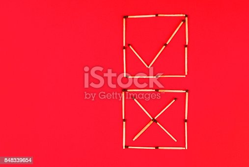 istock Sign correct and incorrectly in check boxes make of matches on red background 848339654