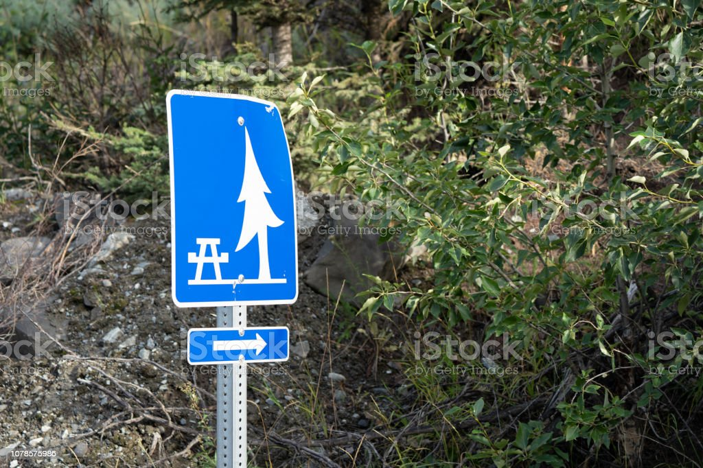 Sign directing to a designated picnic area with tables and shade stock photo